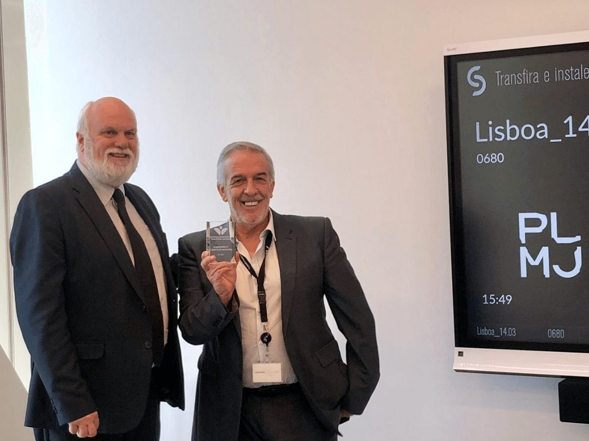 Chris Barton, CEO of the BPCC presenting Luís Pais-Antunes of PLMJ their 50 years Member commemorative plaque
